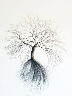 This is a custom made black rusty handmade wire are tree. The idea of making this line came to me with the need to create something else than 3d wire tree,so i decided to create wall trees. This tree consists of approximately 400 strands of black wire around 22-14 gauge 0.6-.0.7 mm