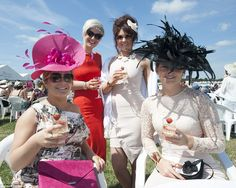 Cheers! A group of ladies enjoy a glass of champagne and show off a spectacular collection of hats