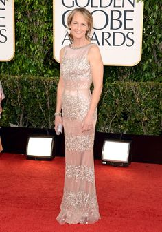 Helen Hunt rocked a Dolce & Gabbana tulle and beaded column gown with rose satin underlay. Hunt wore a pair of Rene Caovilla platinum Swarovski crystal heels and carried an Oroton clutch.