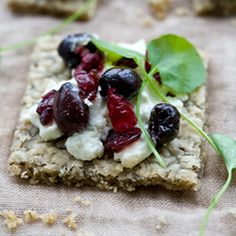 Goat Cheese, Olive, and Cranberry Tartine with a Hazelnut, Chia, and Herb Crust.