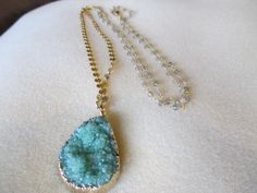 So in love with the incredible green color in this druzy.  A little more excitement is added to this necklace in a gold and gemstone mixed chain.  These mint crystals are so soft and lovely.