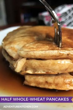 Half the flour in this recipe is whole wheat flour. This makes for a more substantial breakfast, without dramatically changing the taste. You can make a big batch and rewarm them for a quick, nourishing breakfast during the week. #AdventureKitchen #BreakfastIdeas #Pancakes