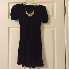 Little black dress Super flattering. Puffy shoulders. Low cut. Flowy so it's constable to eat and dance the night away in. Size xs - true to size. Dresses Mini