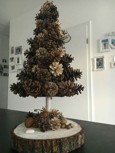 cover a foam cone with brown paper. using a hot glue gun stick on the pine cones. to cover up any gaps I added red berries.kamella's media content and analytics. Pine Cone Christmas Tree, Christmas Wood Crafts, Christmas Makes, Christmas Wreaths, Christmas Crafts, Christmas Ornaments, Pine Cone Art, Pine Cone Crafts, Pine Cones
