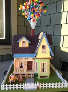 Magnificent Gingerbread houses    Pixar's UP house  Constructed from gingerbread, fondant and marzipan for the figures, with gelatin sheets for the windows, this edible house looks exactly like the real thing. The balloons are gumballs on thin painted wires.