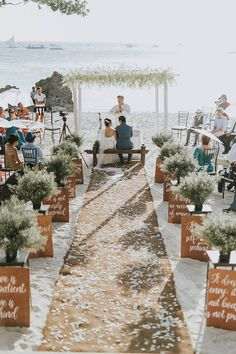 9 Simple Ways to Pull Off a Cool Beach Wedding--one minute wedding guide 9 Simple Ways to Pull Off a Cool Beach Wedding--white petal and burlap lined wedding ceremony with wooden wedding sign a. Beach Wedding Aisles, Beach Wedding Photos, Beach Ceremony, Beach Wedding Decorations, Wedding Ceremony, Wedding Venues, Floral Decorations, Wedding Pictures, Wedding Gowns