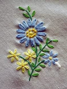 A simple embroidery piece with lazy daisy stitches, french knot center and stem stitch. This looks perfect for teaching grandchildren. It was from a stamped kit for embroidered napkins. Daisy Daisy Embroidery Closeup by ArielManx Lazy Daisy, French Knot a Back Stitch Embroidery, French Knot Embroidery, Embroidery Stitches Tutorial, Silk Ribbon Embroidery, Crewel Embroidery, Vintage Embroidery, Embroidery Kits, Machine Embroidery, Simple Embroidery Designs