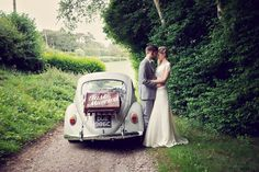 Quirky vintage style rustic wedding at Northease Manor, Lewes. Bride & Groom, wedding car. VW Beetle wedding car, Just Married. Sussex based vintage style photographer www.ruby-roux.com