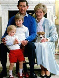 royal family with pet. Dog is cuter than Charles!
