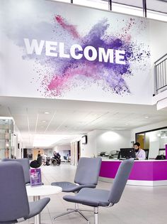 Welcome Graphic. Large Colourful Welcome Graphic Located above a Reception Desk in an Entrance Space. Impactful and Creative. Project by Small Reception Desk, School Reception, Reception Desk Design, Reception Counter, Office Wall Design, Office Interior Design, Office Designs, Autocad, Office Wall Graphics