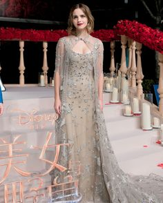 EMMA WATSON WEARS ELIE SAAB Emma Watson attending the Shanghai premiere of Beauty And The Beast wearing a nude embellished Elie Saab gown.