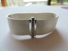 VERY cool Tiffany & Co. Somerset wide silver and diamond bracelet. Fab weave design and front closure.