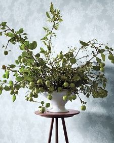 A voluminous and eye-catching apple and crabapple branch centerpiece by Amy Merrick