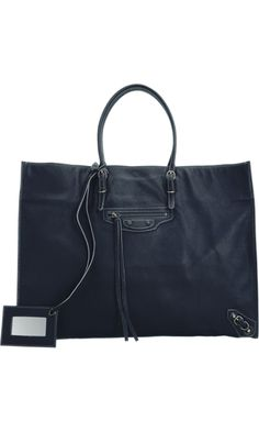 Balenciaga Papier A4. Supple lambskin large tote bag with rolled handles, aged brass-tone shallow front zip pocket and two leather interior organizational pockets