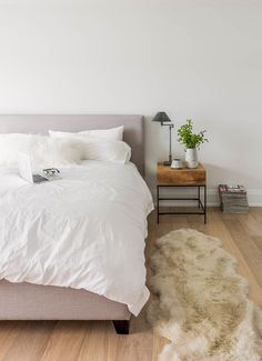 Beautiful faux sheepskin rug in Bedroom Scandinavian with Basement Bedroom next to Wood Floor Area Rug alongside Area Rug Under Bed and Small Master Bedroom Rug Under Bed, Scandinavian Bedroom Decor, Scandi Bedroom, Scandinavian Furniture, Small Nightstand, Nightstand Ideas, Wood Nightstand, Side Table Decor, Side Tables Bedroom