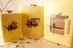 Vintage Mid Century Atomic Kitchen Custard Yellow Plastic Nesting Flour Sugar Tea Canister Set Storage. $22.00