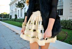 striped sequins and black fur vest