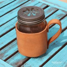 Leather Mason Jar Mug Coozie!    Turn a pint sized jar into a rustic looking mug with a simple leather jacket!  Great gift for father...