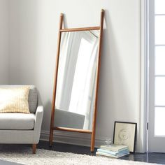 Wondering if I can wall-mount this somehow. Mid-Century Dowel Mirror, West Elm
