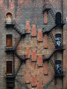 Abandoned Fire escapes in Manhattan Apartment Buidling... love the old doors all bricked up.