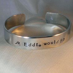 I found this really awesome Etsy listing at https://www.etsy.com/listing/176488757/eddie-would-go-surfing-custom-bracelet