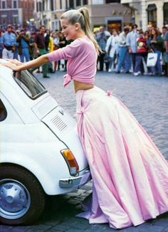 Claudia Schiffer, a ponytailed vision in pink