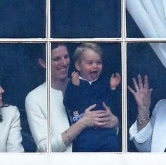Prince George of Cambridge is held by his nanny Maria Teresa Turrion Borrallo as he waves from the window of Buckingham Palace as he watches the Trooping Tthe Colour on June 13, 2015 in London, England.