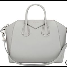 """Nwt givenchy bag Sophisticated satchel crafted of calf leather, which features a subtle pebble-grained texture, has signature detail and a shoulder strap for versatility. Double top handles, 4"""" drop Shoulder strap, 10.5"""" drop Top zip closure One inside zip pocket Two inside open pockets Canvas lining 12.5""""W X 11""""H X 8""""D Calf Leather Made in Italy retails $2700 Givenchy Bags Satchels"""