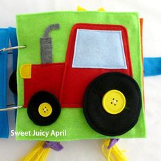 Button wheels tractor page. A felt tractor with wheels that can button on and off of the center hubcap buttons. There is a smaller and larger button with a smaller and larger wheel, so your child can practice matching the sizes together. Can be made in any color scheme. If you want specific colors, let me know. Otherwise I will do the colors that I think look best. All pages are made of felt and measure 8 x 8. *All items made in smoke-free and pet-free environment.* PLEASE NOTE: THIS PAG...