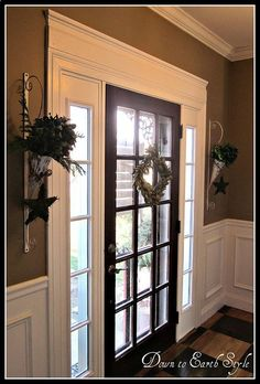 Add extra molding around the front door...paint white. Huge impact!