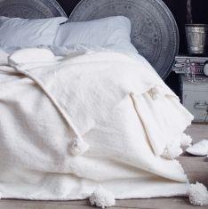 wollen deken met pompoms