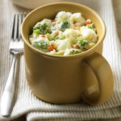 Very Veggie Egg Mug Scrambler™: Broccoli and carrot combined with Egg Beaters and Parmesan cheese in a mug for a speedy breakfast