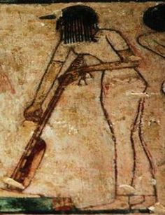 Detail of a tomb wall painting showing a musician girl playing the long luthe violin. Tomb of Rekhmire. 18th dynasty. Gurna, Egypt.