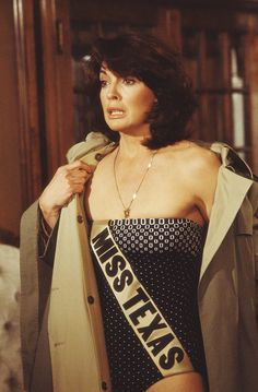 Sue Ellen was Miss Texas when she met JR, a pageant judge. In this episode she was held hostage in the house and forced to put on the swimsuit and sash. Brian Denahy played one on the bad-guys.