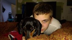 Christopher, youngest son of Warclown guitarist Tim Entwisle, age 14 with one of our rescued Dachshunds, Ciela, age 2. (2017)