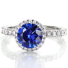 Stunning sapphire engagement ring with a luscious blue center. Micro pave band and halo accentuates the center stone beautifully!