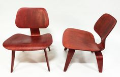 This is an early production Eames Chair ( 1940s) with the 5-2-5 configuration. Red Aniline. Early Evans model! An amazing chair that has been