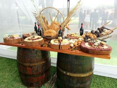 Meat n cheese table set on wooden barrels Cheese Table, Cheese Bar, Food Platters, Cheese Platters, Pizza Wedding, Tableaux Vivants, Appetizers Table, Italian Party, Wine And Cheese Party