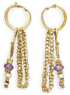 A PAIR OF BYZANTINE GOLD, PEARL, BANDED AGATE AND AMETHYST EARRINGSCIRCA 5TH-6TH CENTURY A.D.Each composed of a plain hollow hoop, tapering at each end to plain wire forming a hook-and-loop closure, the loop extending and coiled back around the hoop, suspending a drop composed of wire spiraled along its length, topped by a large granule, threaded through rounded banded-agate, pearl and biconical amethyst beads, alternating with gold spacers, increasing in size up the length, also suspending…