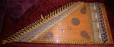 """KANUN: The kanun is one of the kithara class of instruments. Kithara is the common designation for instruments in which the sound is produced by the vibration of taut strings arranged """"openly"""" from short to long. #turkish #instrument"""