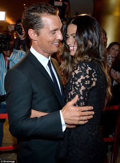 Matthew McConaughey and his wife Camila Alves arrive cuddled up on the red carpet