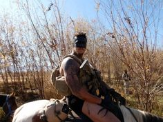 """Navy SEAL """"Half Face Blades"""" wearing half face warpaint while riding a horse in Afghanistan. [960x720]"""