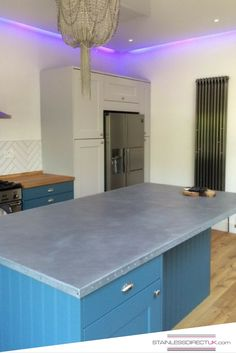 We love this galvanised worktop that we did with a Chesterfield style studding around the edge. What do you think?
