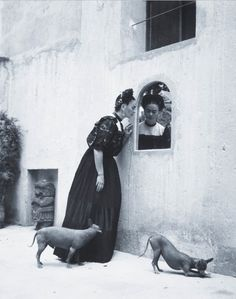 Frida Kahlo and her Xoloitzcuintli dogs.