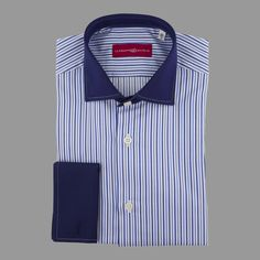A white and blue stripe shirt, with a blue windsor collar and a blue double cuff