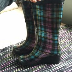 BRAND NEW! Plaid rain boots with wedge heel Brand new, never worn pair of Capelli plaid rain boots with a wedge heel. I love these boots but never got to wear them because they are too small for me :( they are super cute for rainy days or just to wear out anytime! Capelli Shoes Winter & Rain Boots
