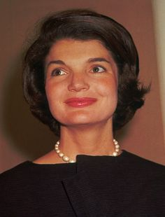 This 1961 file photo shows Jacqueline Bouvier Kennedy, wife of President John F. Kennedy. A special summer exhibit on Jackie Kennedy's life on Cape Cod has opened at the John F. Kennedy Hyannis Museum. The exhibit includes photos, handwritten letters and other artifacts from her time on the Cape. The curator said the exhibit captures Kennedy enjoying carefree days with her family, a different glimpse of a woman who was an international sensation.