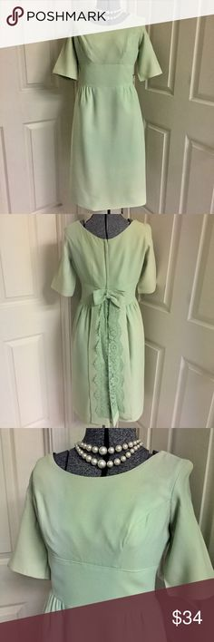 VINTAGE mid-century SAGE green dress Gorgeously GREEN vintage dress in GREAT condition! Back zip with hook/eye closure. Short train with adorable top BOW & feminine lace is removable! Attaches easily with 2 hook/eye clasps. Dress has been professionally dry cleaned. MINOR fade to fabric (unnoticeable in the pics) & there are 2 small spots shown in last pic. Dress is still in GREAT wearable condition, well-made, with wonderful quality fabric (likely crepe). Union label with size tag 13…
