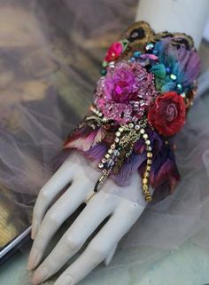 Romantic bold wrist wrap; is made of vintage & antique laces and trims- base is of vintage silk velvet, embellished with genuine antique bronze lace dating back 1920,antique bronze and black trim at top edge of cuff; my hand painted ombre silk flounce in purple and blue shades. Cuff is