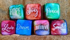 These Inspirational word Painted Rocks are wonderful as small kindness reminders for your home, to share with friends, or to leave in your community to brighten someone's day. With the holidays coming up they are also perfect stocking stuffers! Motivational Gifts, Inspirational Gifts, Plastic Display Stands, Rock Hand, Dandelion Wish, Hand Painted Rocks, Painted Stones, Kindness Rocks, Organza Gift Bags